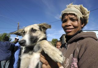 A pet owners brings her dog to be spayed by IFAW's Prince Albert Sterilisation Project underway in South Africa (June 2010). Picture: IFAW/Trevor Samson.